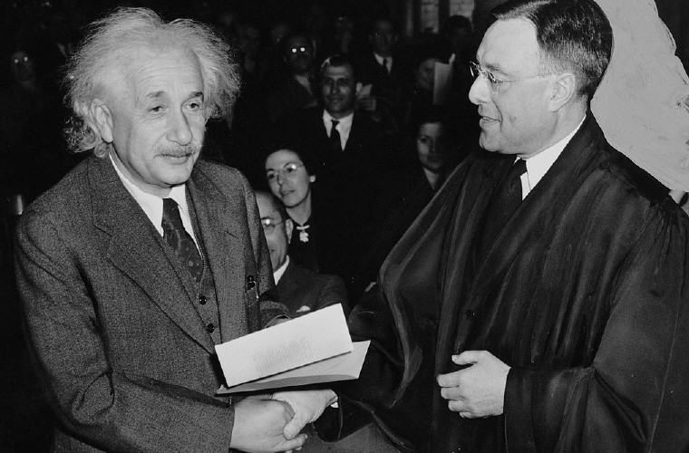 Albert Einstein receiving from Judge Phillip Forman his certificate of American citizenship, 1 October 1940