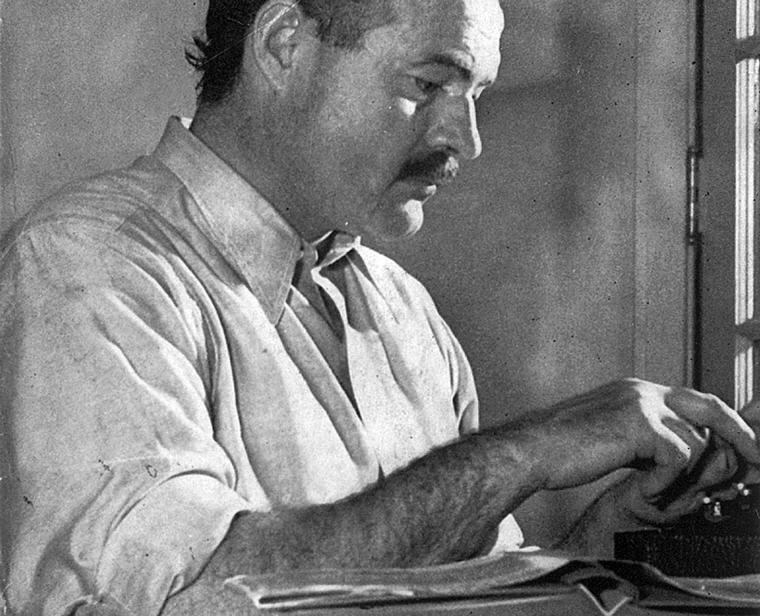 Hemingway working on his book For Whom the Bell Tolls at the Sun Valley Lodge, Idaho in December 1939, Photo credit: Wikipedia
